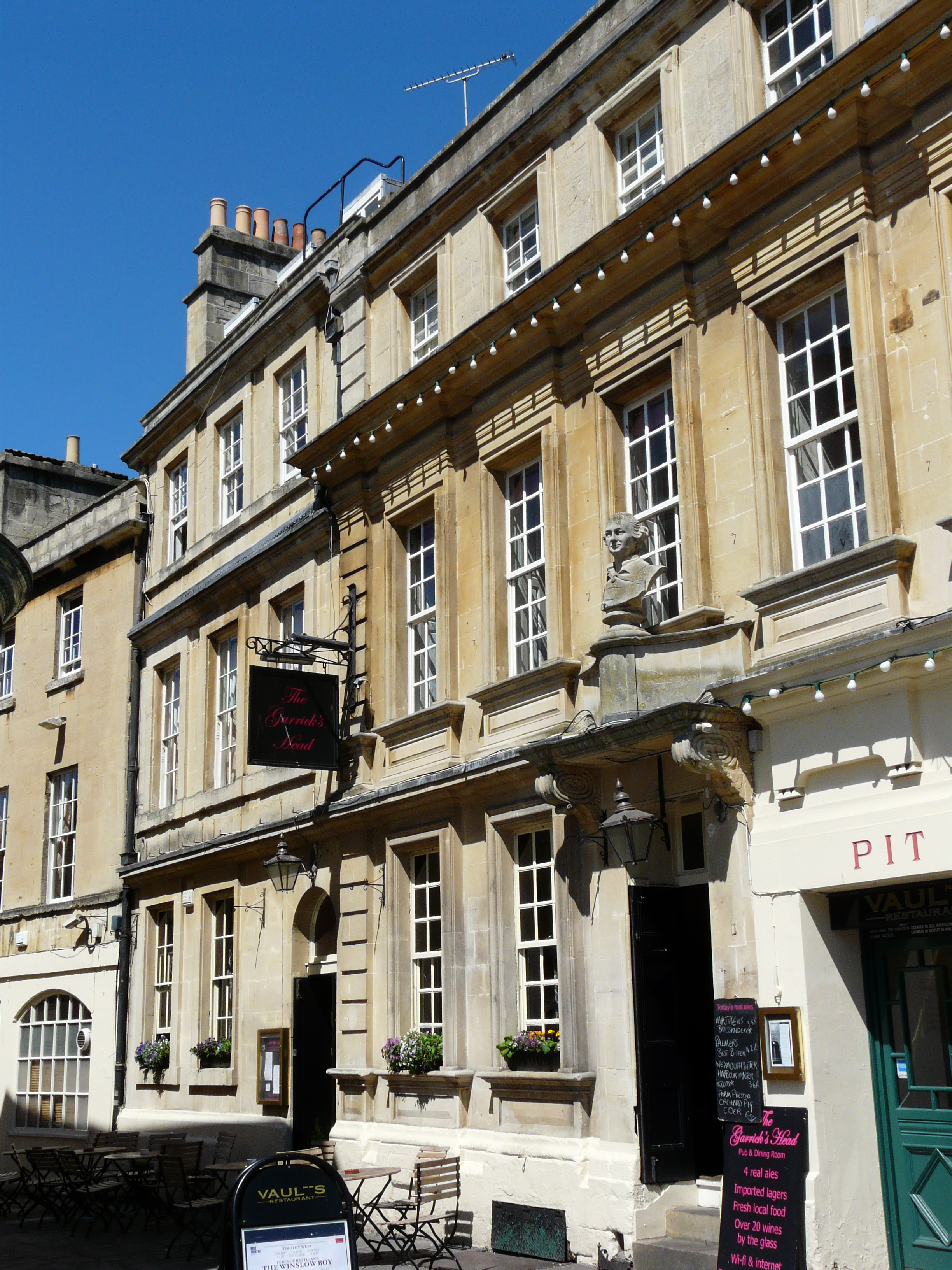 The front of the Georgian building which houses the Garrick's Head on a sunny summers day, with the bust of Garrick over the door