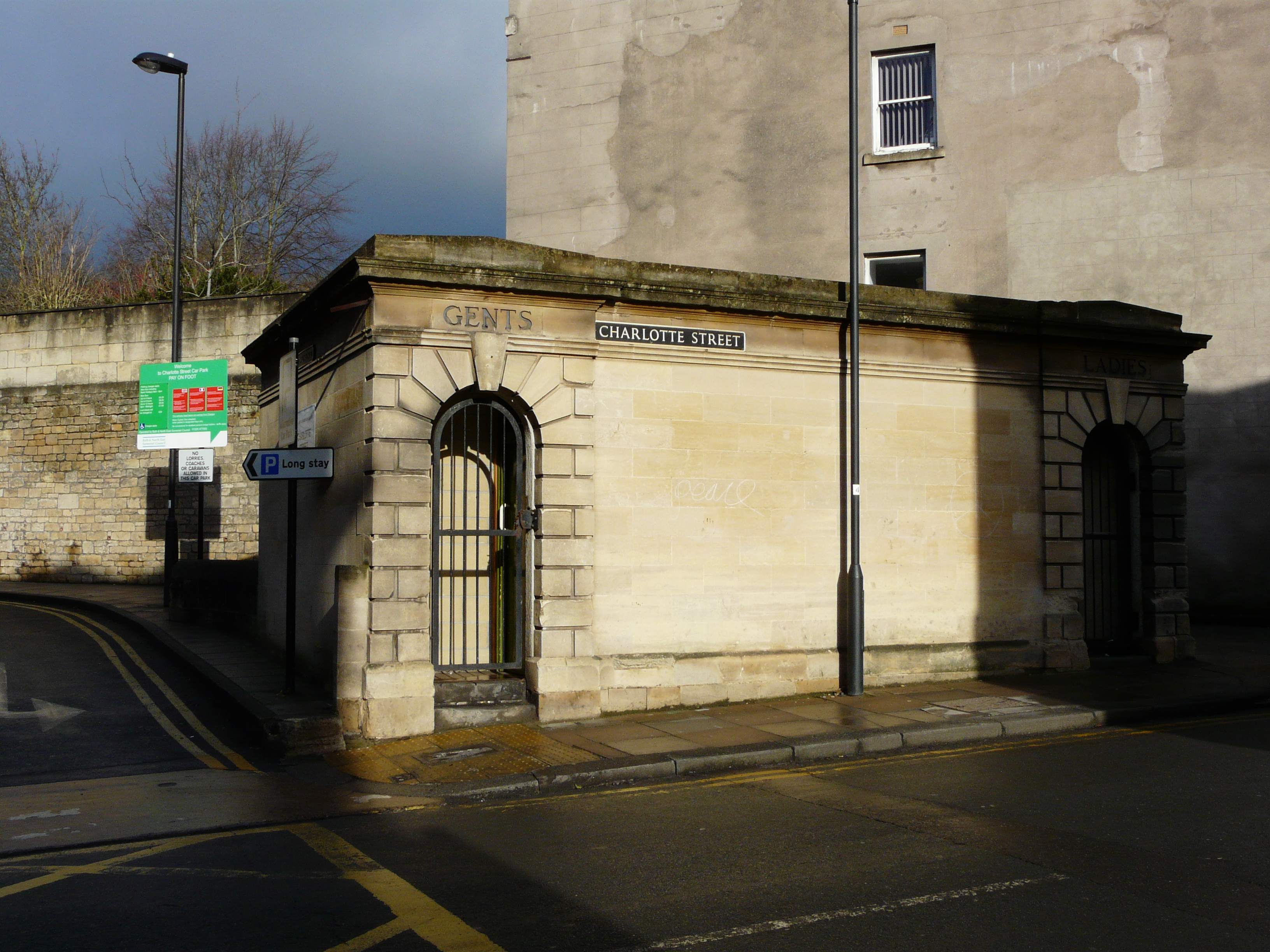Elegant stone-built toilet block on a bright winter's day