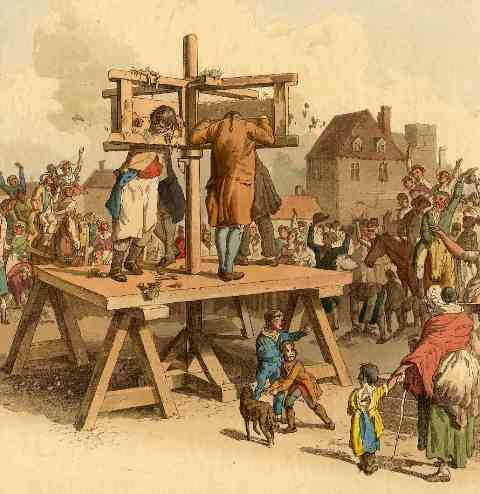 Pilloried prisoners in 18th century dress walk in circles on the pillory platform while a large crowd of all ages jeers and gawks at them