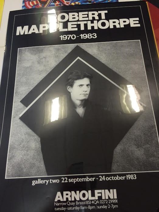 Arnolfini poster for the Robert Mapplethorpe photographic exhibition in 1983. A self-portrait photograph of Mapplethorpe, a standing young man in a dark suit