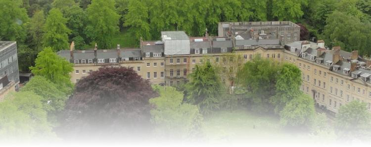 View of Berkeley Square from a height showing Regency houses on two sides and the trees of Brandon Hill behind.