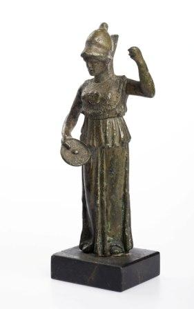 Ancient bronze statue of woman wearing a helmet, left arm raised and right hand holding a discus