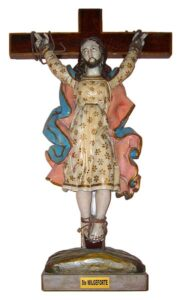 Wooden statue of a bearded lady with a floral dress being crucified