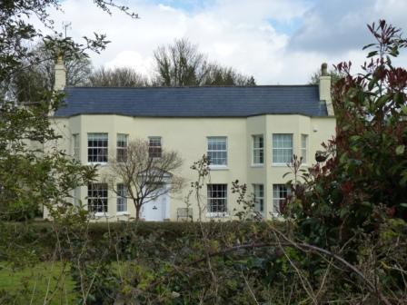 Grand 2-storey early 19th century house set amongst trees and large garden